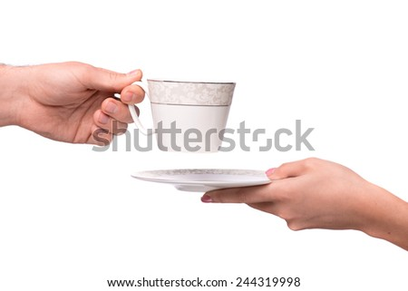 Enjoy the cup of coffee! Cropped image of the cup of coffee passing from one hand to another isolated on white background