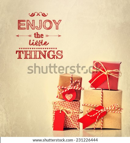 Enjoy the Little Things text, with handmade gift boxes - stock photo