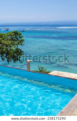 Enjoy the ocean view infinity pool on vacation.Bali.Indonesia. - stock photo