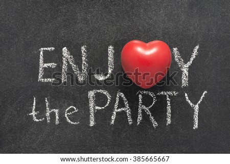 enjoy the party phrase handwritten on chalkboard with heart symbol instead of O