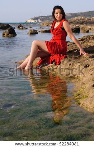 Enjoy the Summer; Fashionable young woman enjoying the water