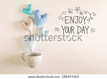 Captivating Enjoy Your Day Message With Blue Heart Cushions Coming Out Of A Coffee Cup