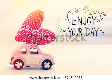 Superieur Enjoy Your Day Message With Miniature Pink Car Carrying A Heart Cushion