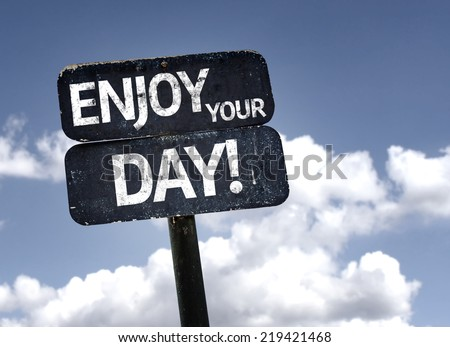 Enjoy Your Day sign with clouds and sky background - stock photo