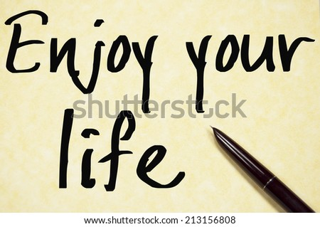 enjoy your life text write on paper  - stock photo