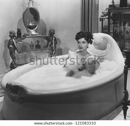 Enjoying a bubble bath - stock photo