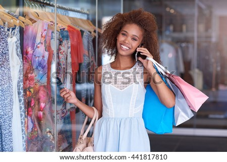 Enjoying a day at the shopping mall - stock photo