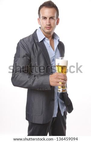 Enjoying a tall cool beer - stock photo