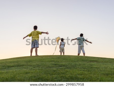 Enjoying childhood at summer vacation - stock photo