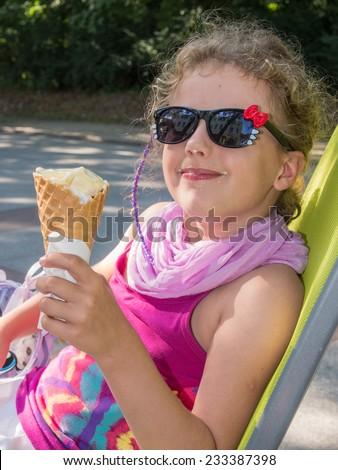 Enjoying ice cream on Kolobrzeg Promenade during summer vacations. - stock photo