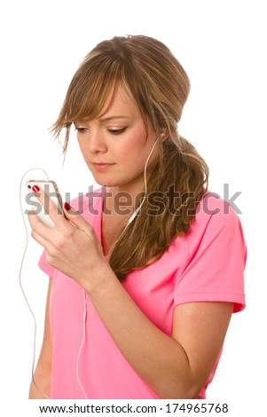 Enjoying Music On Smart Phone - This is a photo of a cute young woman ready to listen to some music on her ipod. Shot on an isolated white background with a shallow depth of field. - stock photo