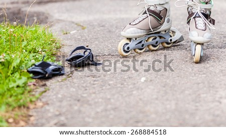 Enjoying roller skating rollerblading on inline skates sport in park. Outdoor activities.  - stock photo