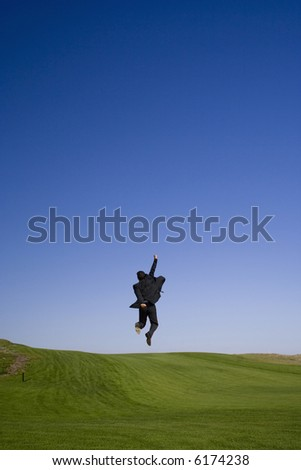 Enjoying the business sucess on a golf course - stock photo