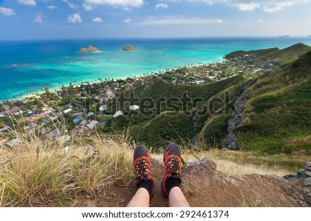 Enjoying the view on the Lanikai Pillboxes Trail in Oahu, Hawaii. View of the Lanikai Beach and the Mokulua Islands. - stock photo