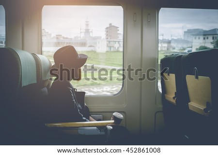 Enjoying travel. Young pretty woman traveling by the japan classic train sitting near the window. vintage filter. - stock photo