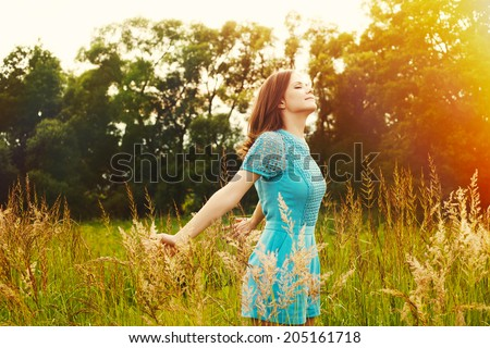 Enjoyment. Free Happy Woman Enjoying Nature. Beauty Girl Outdoor. Freedom concept. Beauty Girl over Sun - stock photo