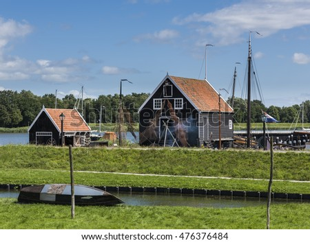 Enkhuizen, The Netherlands - August 9, 2016: Zuiderzee Museum Enkhuizen with old fisherman house, fishing gear and boat in The Netherlands.