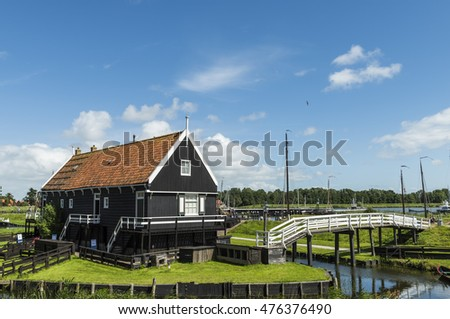 Enkhuizen, The Netherlands - August 9, 2016: Zuiderzee Museum Enkhuizen with old fisherman house and white bridge in The Netherlands.