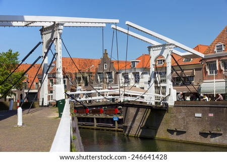 ENKHUIZEN, THE NETHERLANDS - MAY 15: Draw bridge over a canal in the historic center of enkhuizen on May 15, 2014 in Enkhuizen, The Netherlands. The city was once one of the harbour-towns of the VOC.  - stock photo