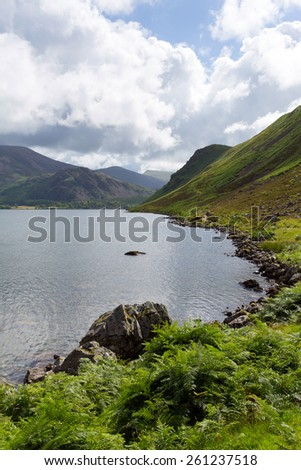 Ennerdale Water Lake District National Park Cumbria England uk surrounded fells including Great Gable, Green Gable, Brandreth, High Crag, Steeple and Pillar  - stock photo