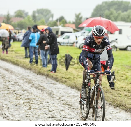 ENNEVELIN, FRANCE - JUL 09: The French cyclist Sylvain Chavanel  (IAM Cycling) riding on a cobbled road during the stage 5 of Le Tour de France in Ennevelin on July 09 2014.
