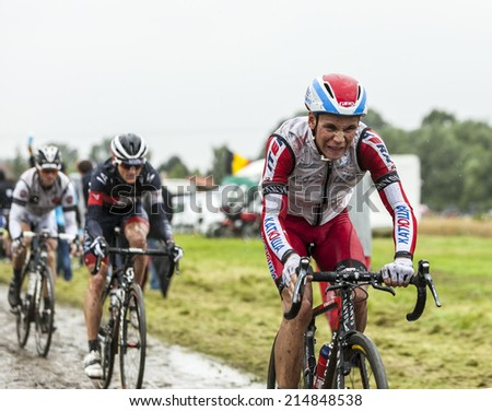 ENNEVELIN, FRANCE - JUL 09: The Spanish cyclist Joaquim Rodriguez (Katusha Team) riding on a cobbled road during the stage 5 of Le Tour de France in Ennevelin on July 09 2014.