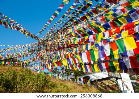 enormous amount of buddhist praying flags decorating temple in nepal - stock photo
