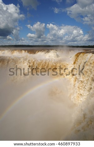 Enormous amounts of water thundering down the devil's throat at Iguazú waterfall, Argentina