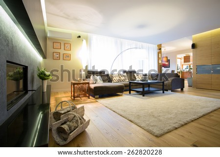 Enormous bright lounge with big comfortable sofa - stock photo