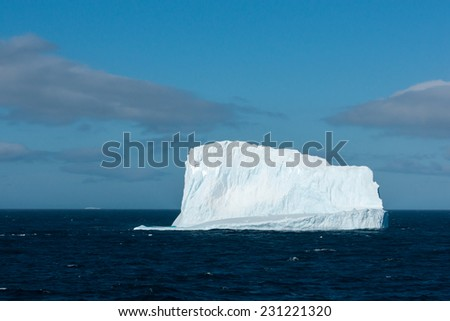 Enormous melting iceberg near Antarctica - stock photo