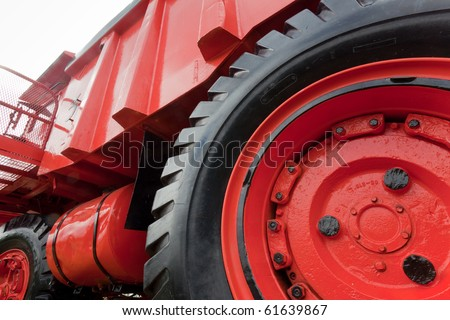 Enormous wheel, rim and tire, of vinatge giant mining truck - stock photo