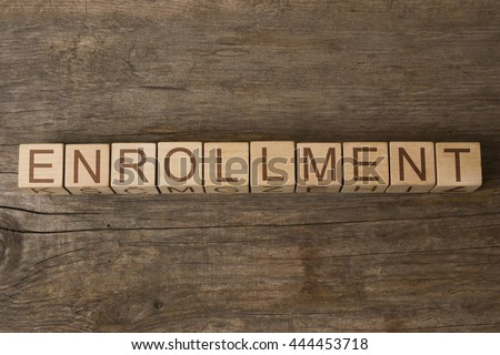 ENROLLMENT word on wooden cubes