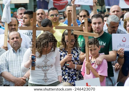 ENSCHEDE, NETHERLANDS - AUG 03, 2014: During a demonstration organized by suryoye christians against the slaughter of christians in the middle east there is a minut of silence for those who are dead - stock photo