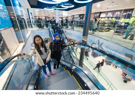 ENSCHEDE, NETHERLANDS -AUG 19, 2014: People are shopping in a new branch of warehouse Primark on the first day at the opening, August 19, 2014 in the Netherlands - stock photo