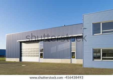 ENSCHEDE, NETHERLANDS - NOVEMBER 28, 2015: Exterior of a modern industrial warehouse with office building