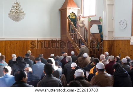 ENSCHEDE, THE NETHERLANDS - FEB 13, 2015: Muslims have gathered for the friday afternoon prayer in a mosque and are listening to the speech of an imam - stock photo