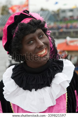 ENSCHEDE, THE NETHERLANDS - NOV 14, 2015: Black Pete is the helping hand of the dutch Sinterklaas
