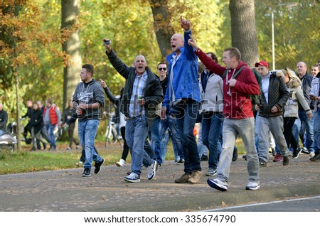 ENSCHEDE, THE NETHERLANDS - OCT 31, 2015: People are demonstrating against a huge migrant refugee camp for syrians close to the part of the city where they live. - stock photo