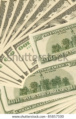Ensemble of the dollars, value one hundred dollars, on plane. - stock photo