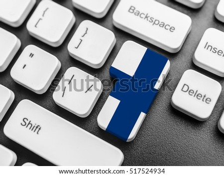 Enter key button with Flag of Finland. Close-up.
