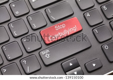 Enter key Stop cyberbullying on black keyboard - stock photo