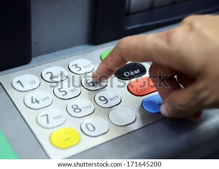 Enter password in the ATM machine concept of banking and security - stock photo