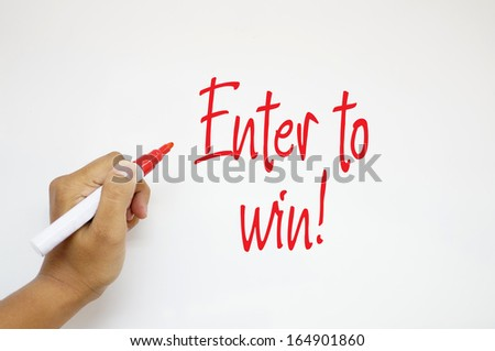 Enter to win! sign on whiteboard - stock photo