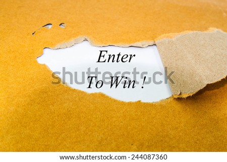 enter to win text concept on brown envelope  - stock photo