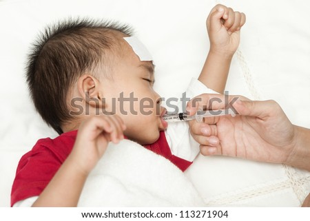 Entering medicine asian baby sleeping and suffering fever heat