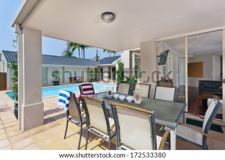 entertainment area in patio outside of modern australian home - stock photo