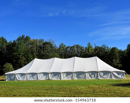 entertainment tent in the meadow - stock photo
