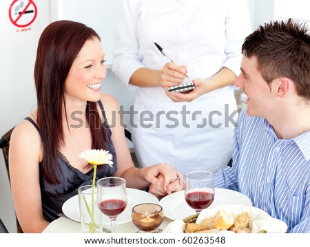 Enthusiastic couple dining at the restaurant - stock photo