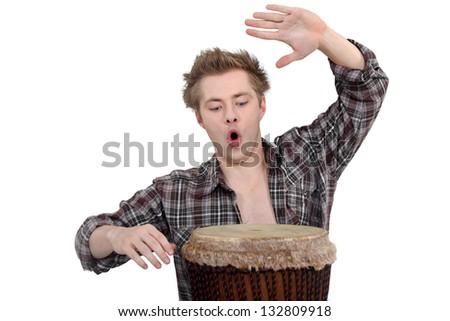 Enthusiastic man playing the bongo drum - stock photo