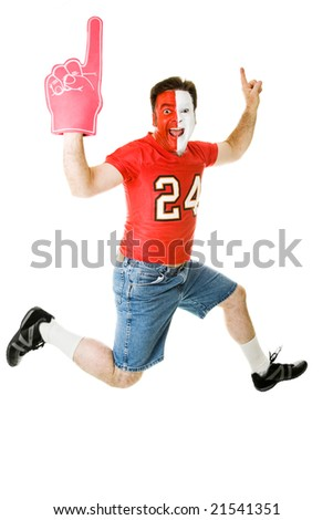 Enthusiastic sports fan jumping for joy over his team's success.  Full body isolated on white.